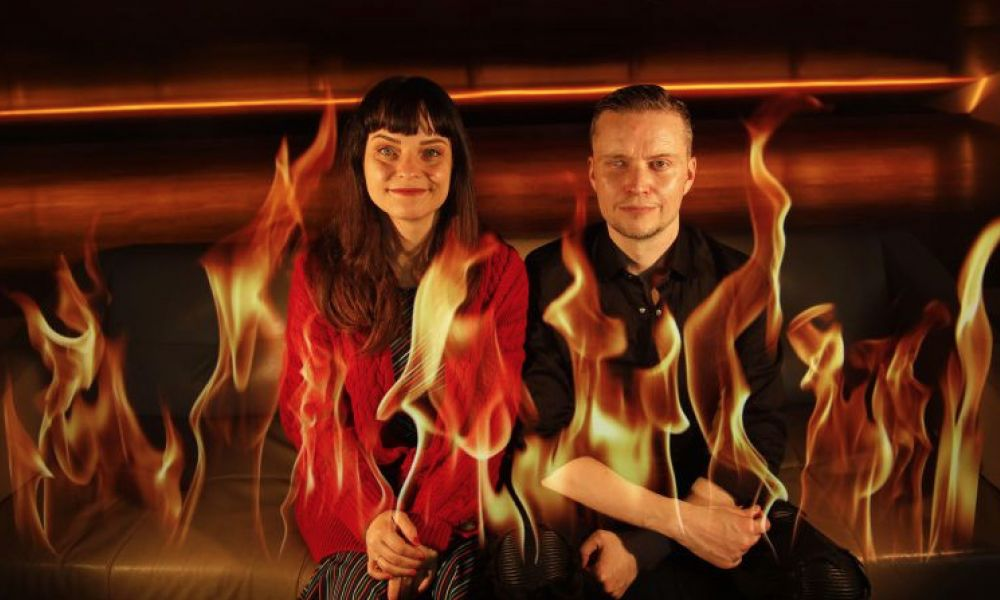 Image of two people sitting in fire