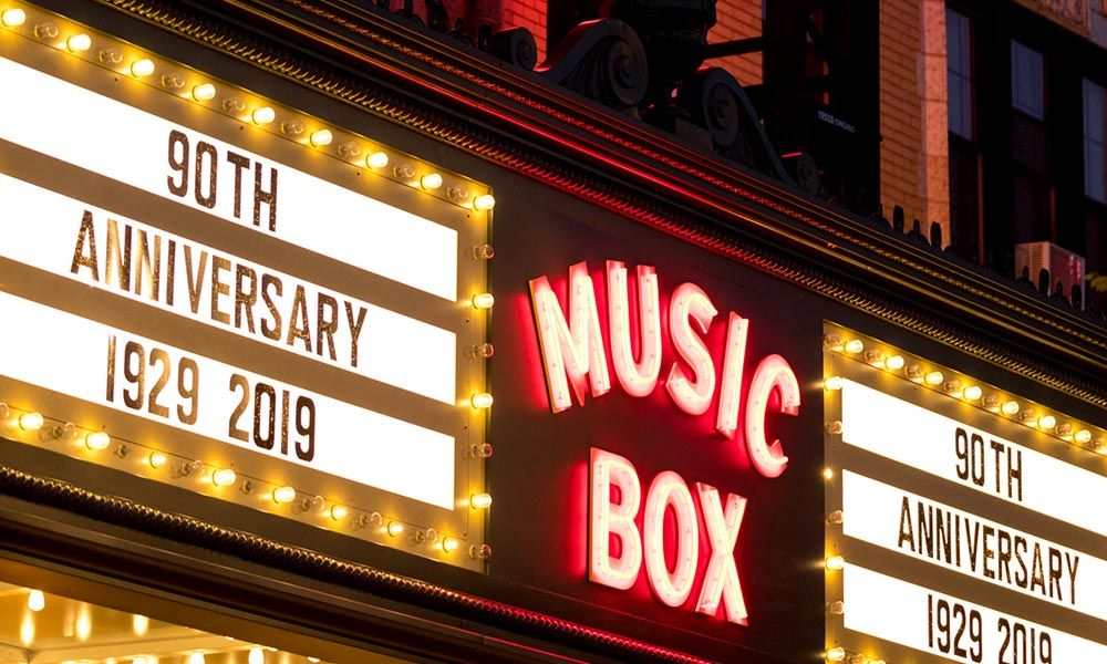 "Photo of the Music Box Theatre marquee lettering saying ""90th Anniversary 1929–2019"""