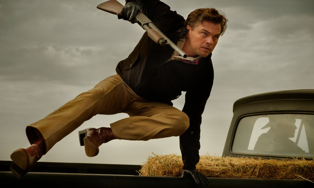 Man jumping out of a pickup truck with a shotgun in Once Upon a Time in Hollywood