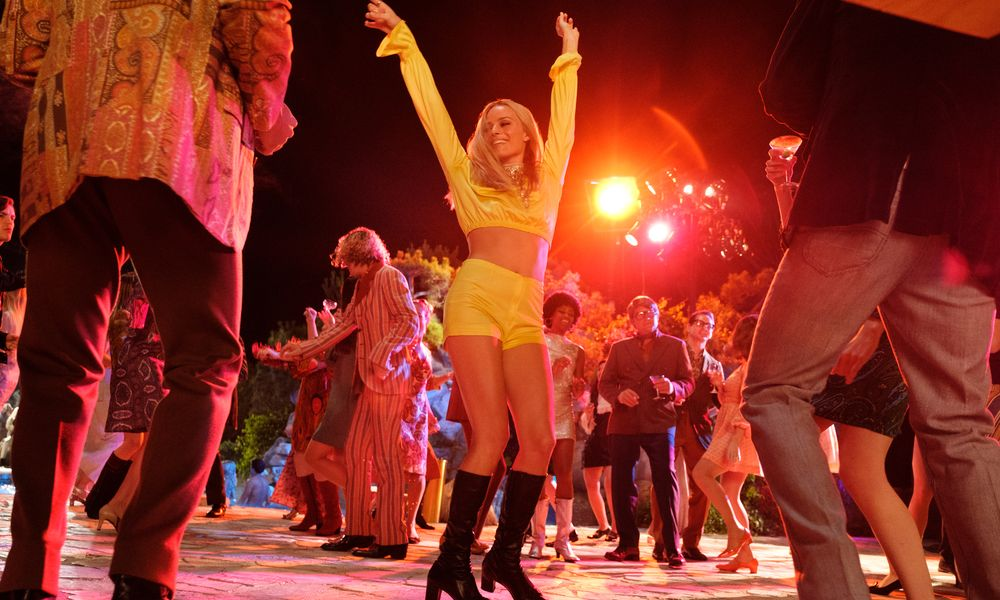 Woman dancing in yellow dress in Once Upon a Time in Hollywood.