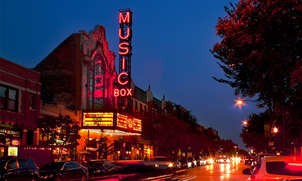 Music Box Theatre lit up at night.